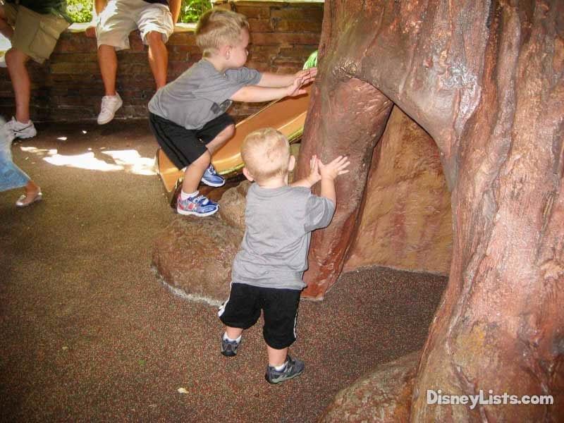 Toddlers on playground near Splash Mountain